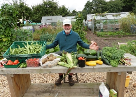 Root 'n' Fruit Community Allotment Bob Bennett displaying their vegetable harvest