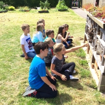 St Albans Primary School children at their bug hotel in their Cultivation Street Garden