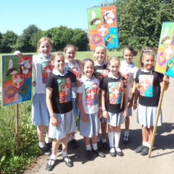 St Albans Primary School children promoting the insects and wild flowers in their Cultivation Street Garden