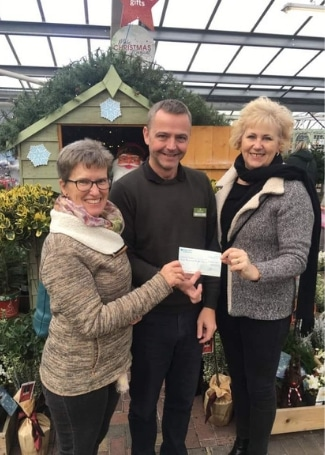 Notcutts Rivendell, David presenting a cheque to the Wonky Garden for £300 from the sales of carrier bags