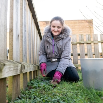 Child planting bulbs at a local hospital, arranged by Cultivation Street Dobbies ambassador Georgina Isherwood