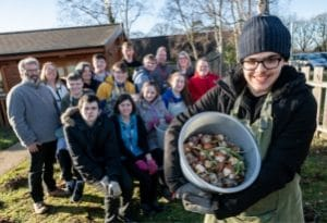 Cultivation Street ambassador, Georgina Isherwood from Dobbies with volunteers planting bulbs