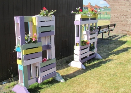 Highfield Park's pallet planters in their Calliope Colour My Life entry in the 2018 Cultivation Street competition