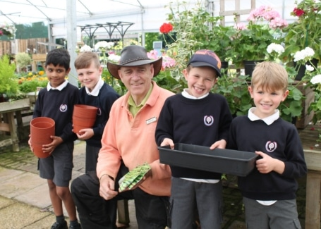 Cultivation Street Ambassador Graham Bicker from Graham Bicker Little Heath Garden Store with children from a local primary school
