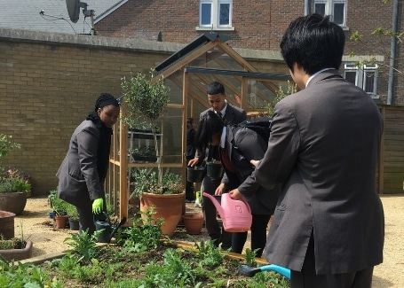 Hammersmith Academy students watering their Cultivation Street garden