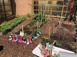Wellie planters in one of the gardens Notcutts Jackie Barker has worked with during the 2018 competition