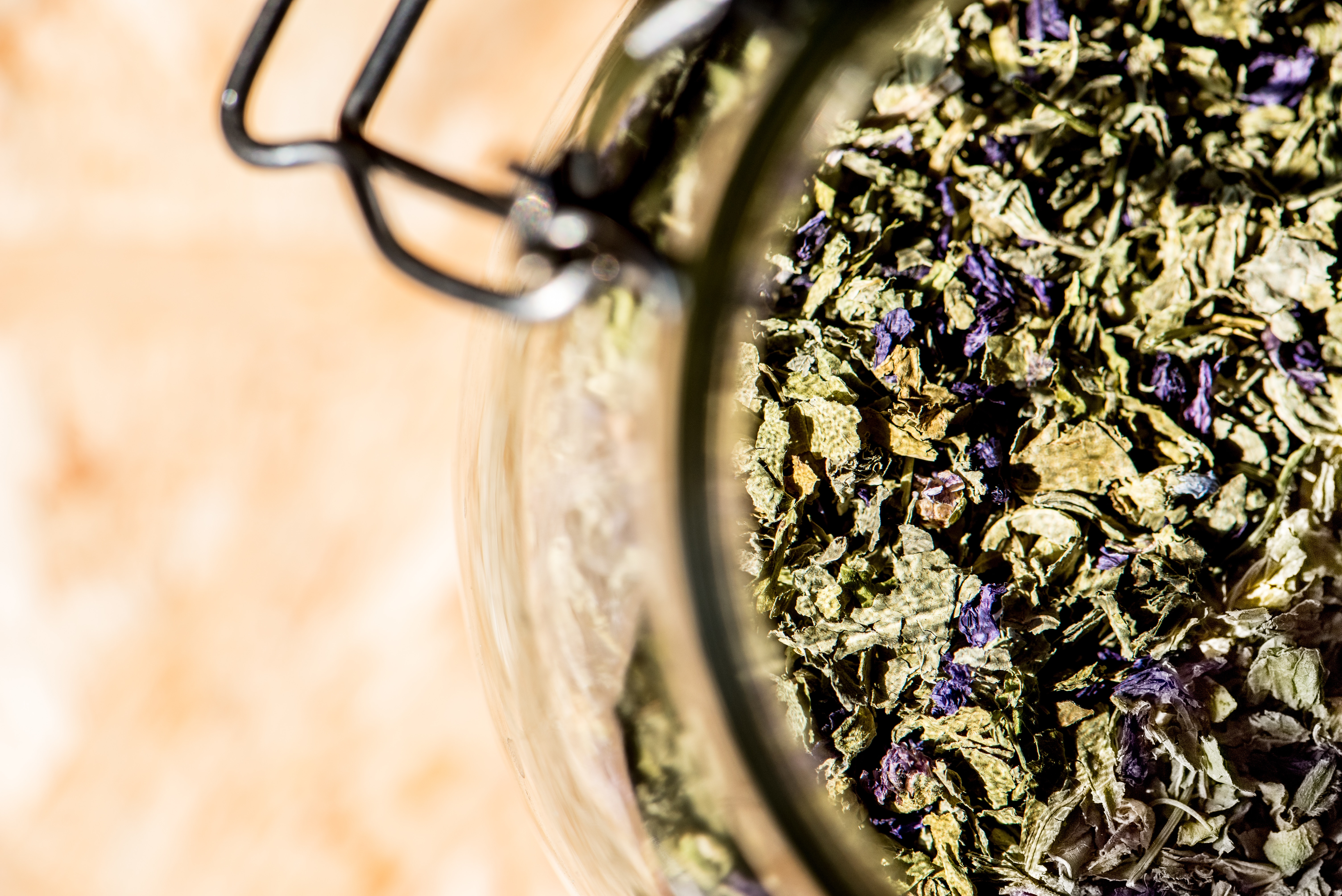 glass jar full of mallow, leaves and flowers for healthy infusion, mallow tea