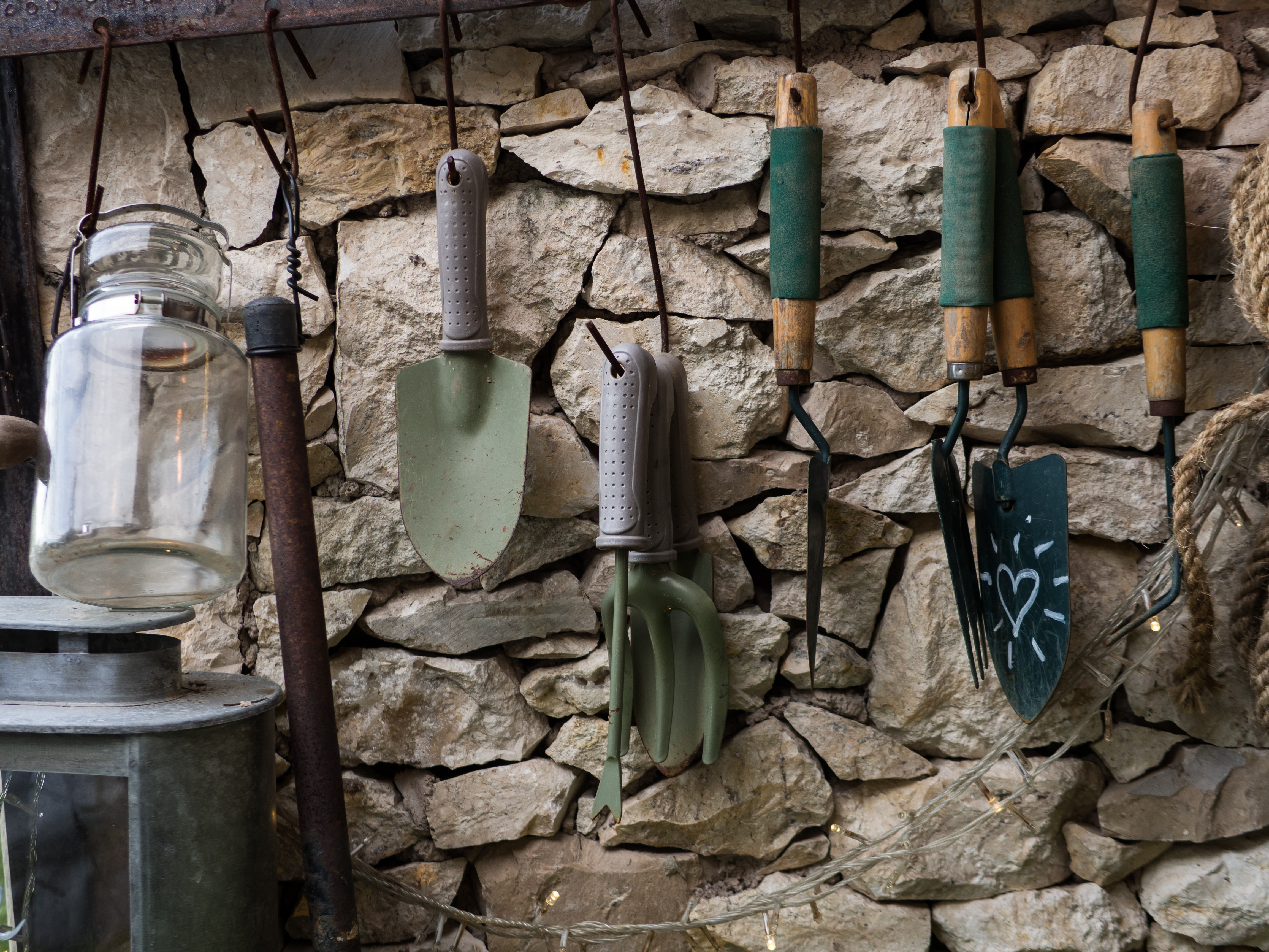 garden equipment hanging on the wall