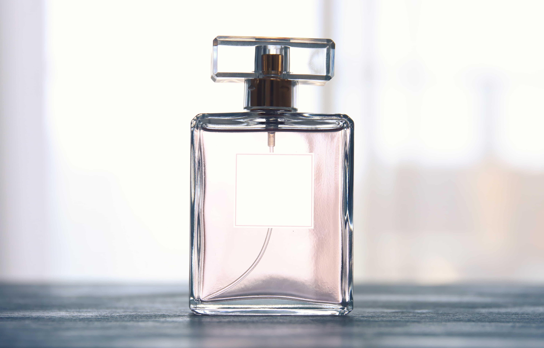 Image of elegant perfume bottle. back light photo.