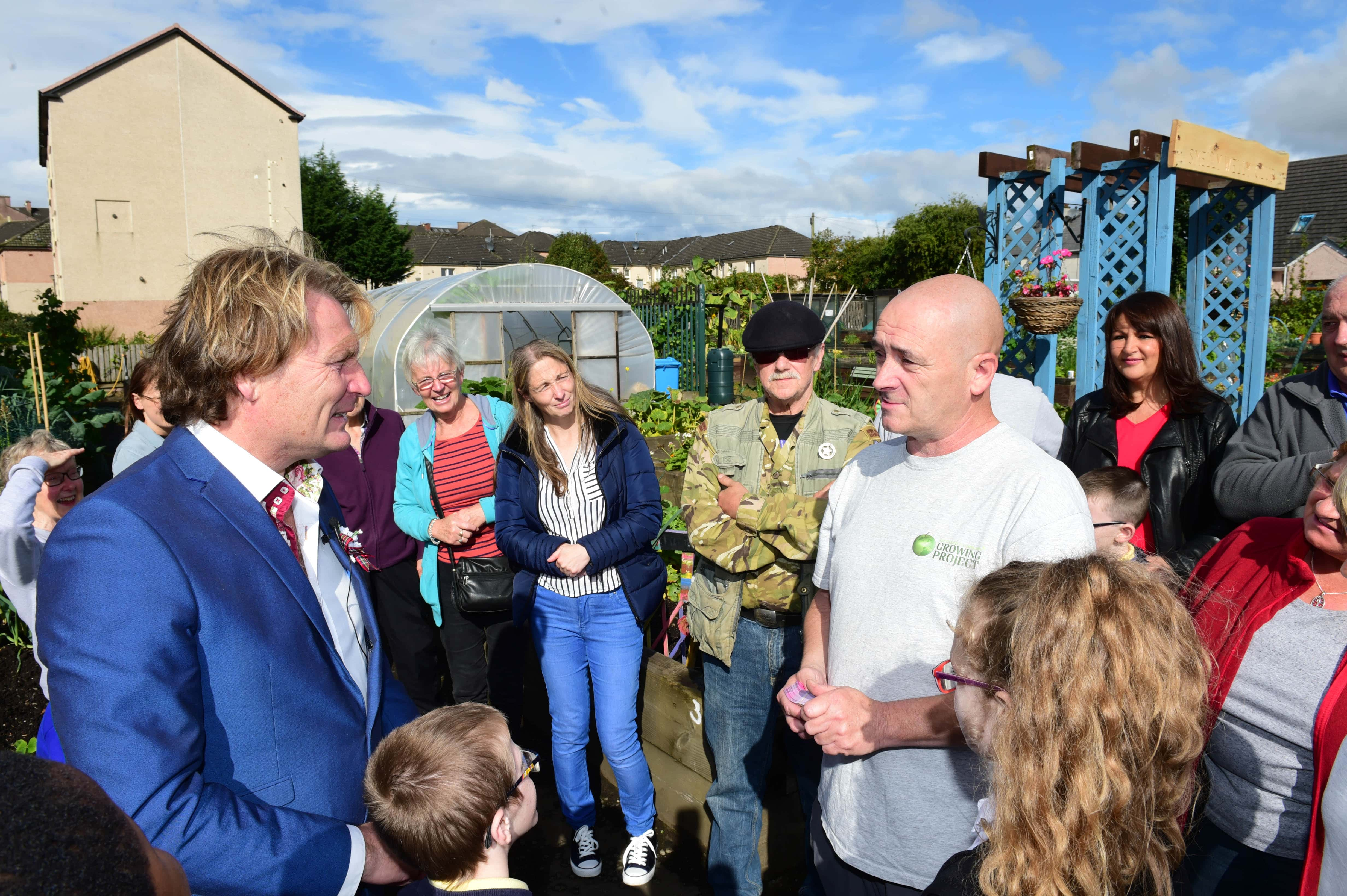 Shettleston Community Growing Project in Glasgow, TV Gardener David Domoney announces that the project are the winners of Cultivation Street and win £10,000. Pictured here with a shocked Kenny Mc Cubbin from the allotment and gardens team. Picture by Paul Chappells 11/09/17