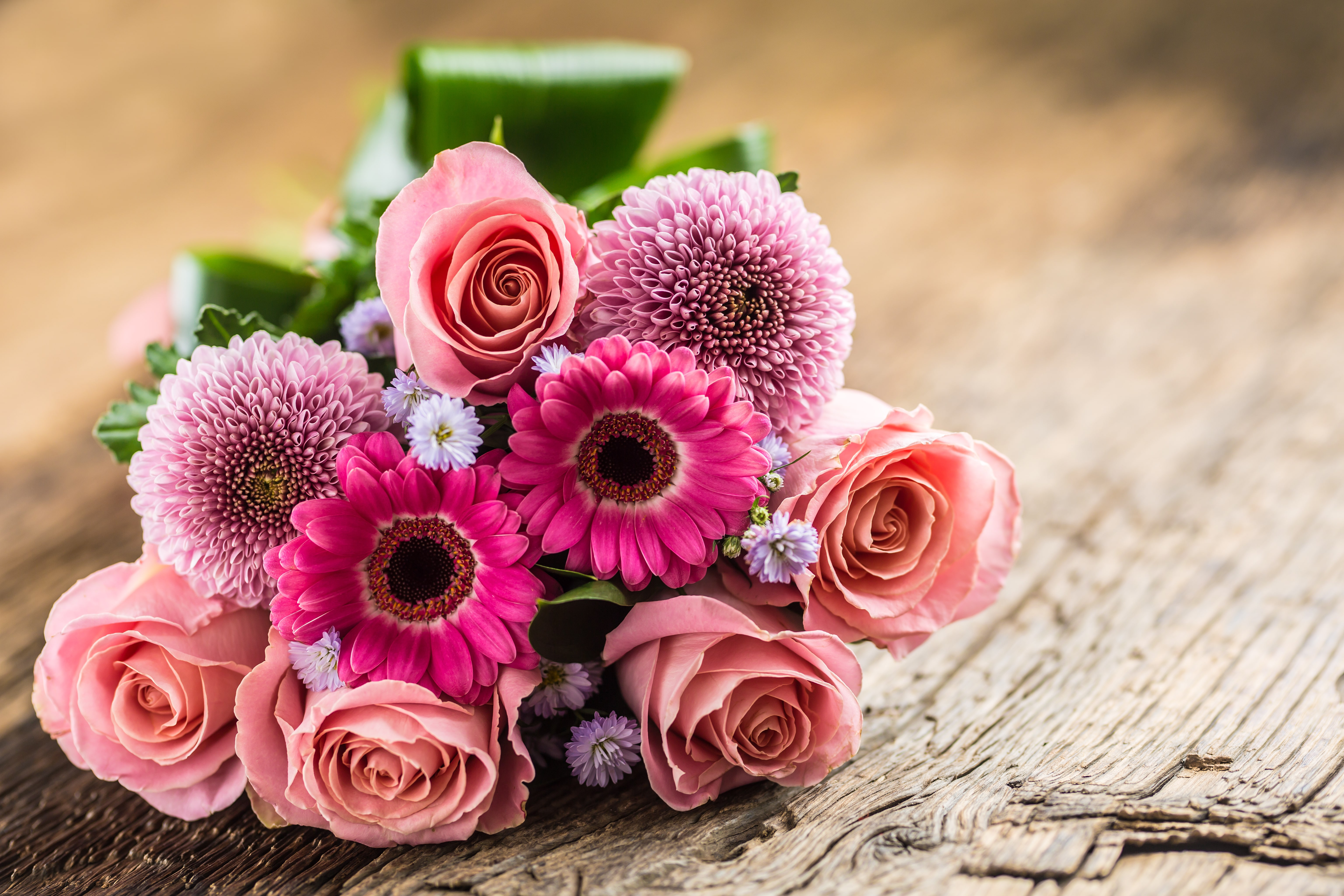 Close-up beautiful bouquet of flowers on wooden table.