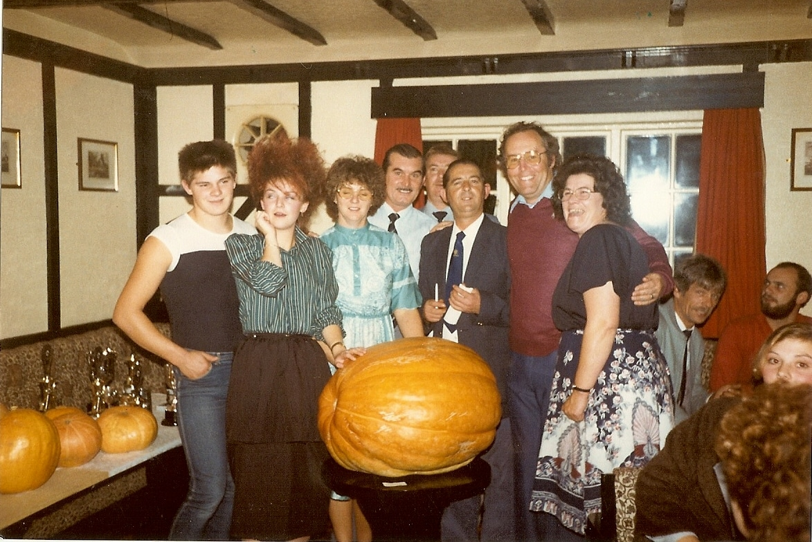 1980s start of pumpkin championships dad in purple jumper
