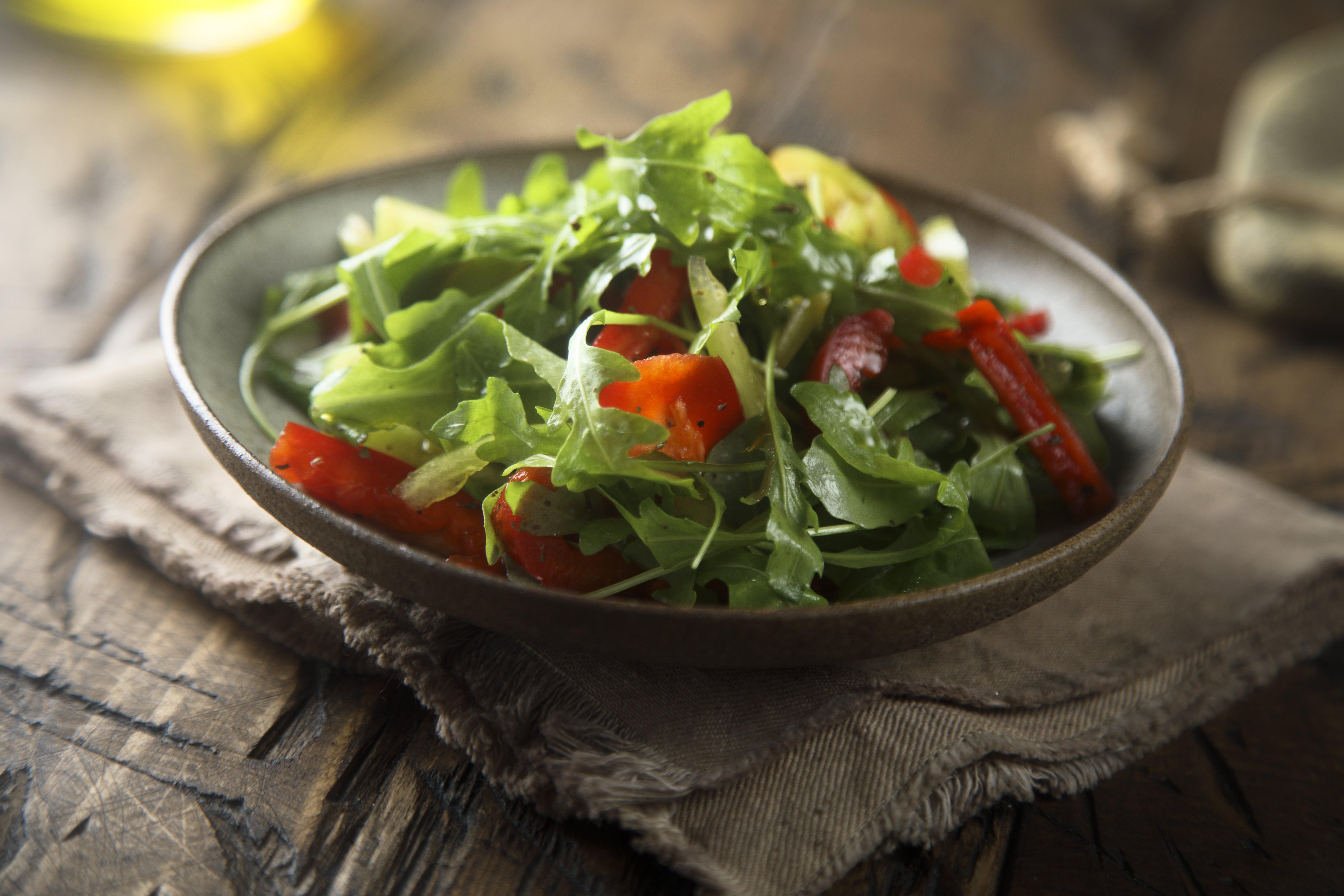 Healthy arugula salad with vegetables
