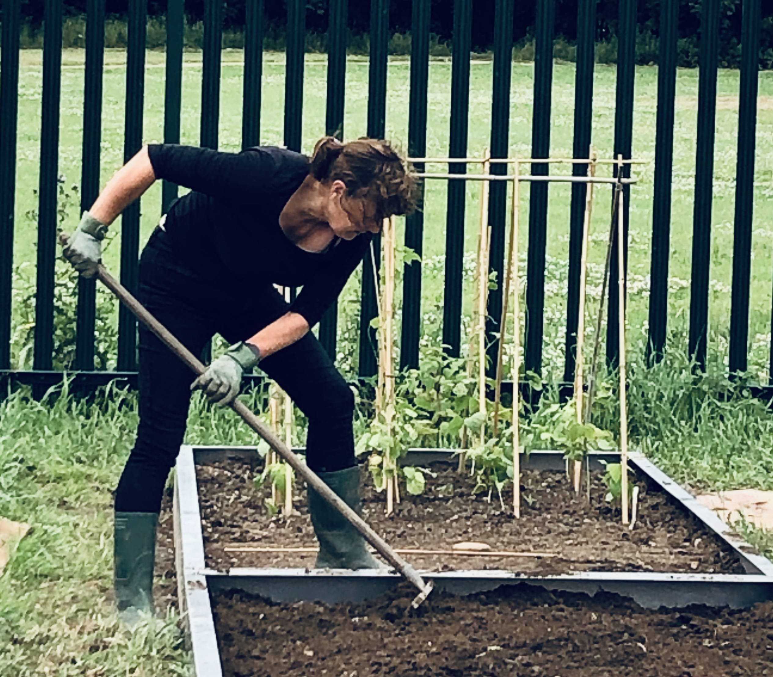 Angela-raking-in-Kitchen-Garden