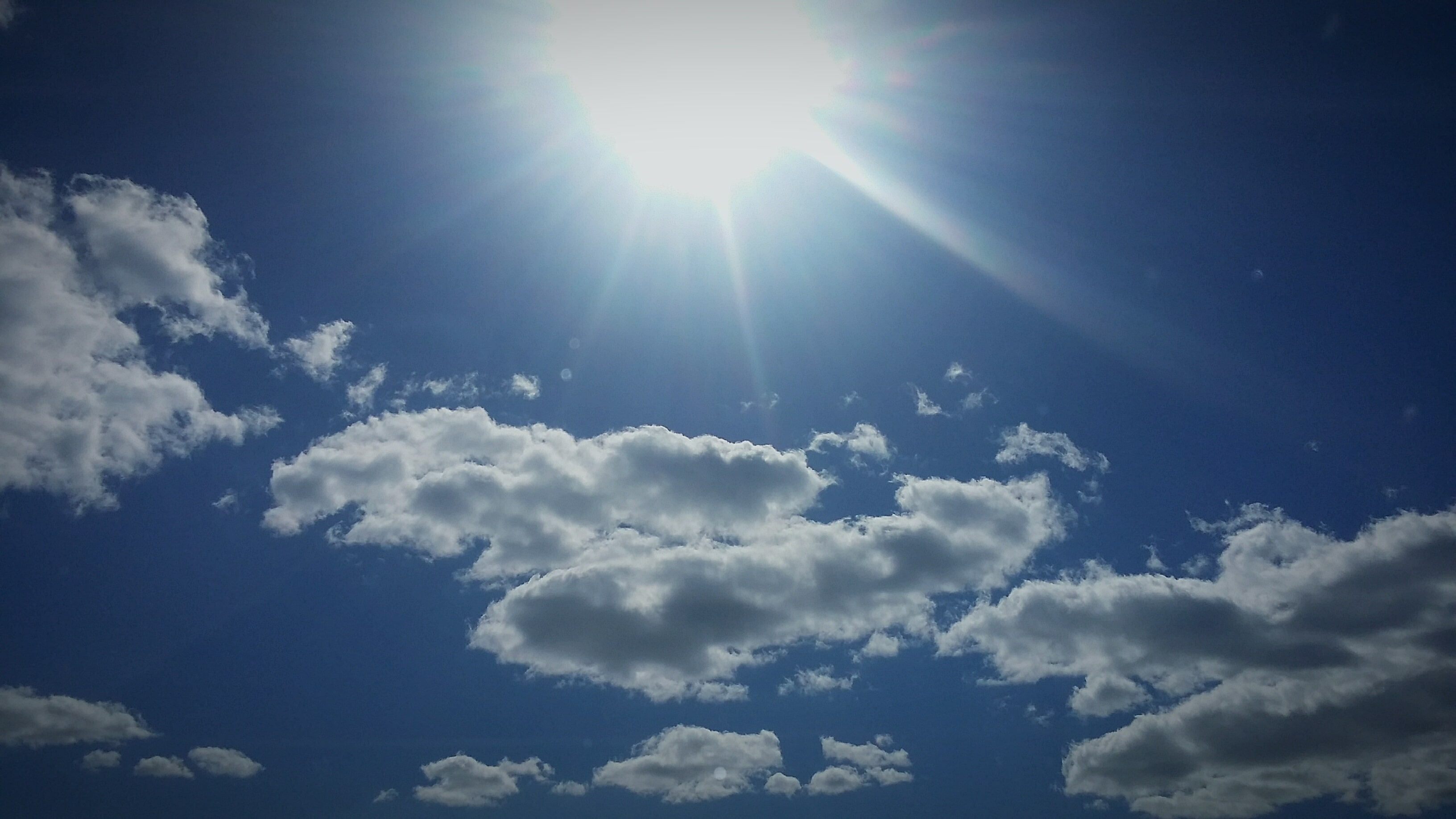 Low Angle View Of Bright Sunshine In Sky