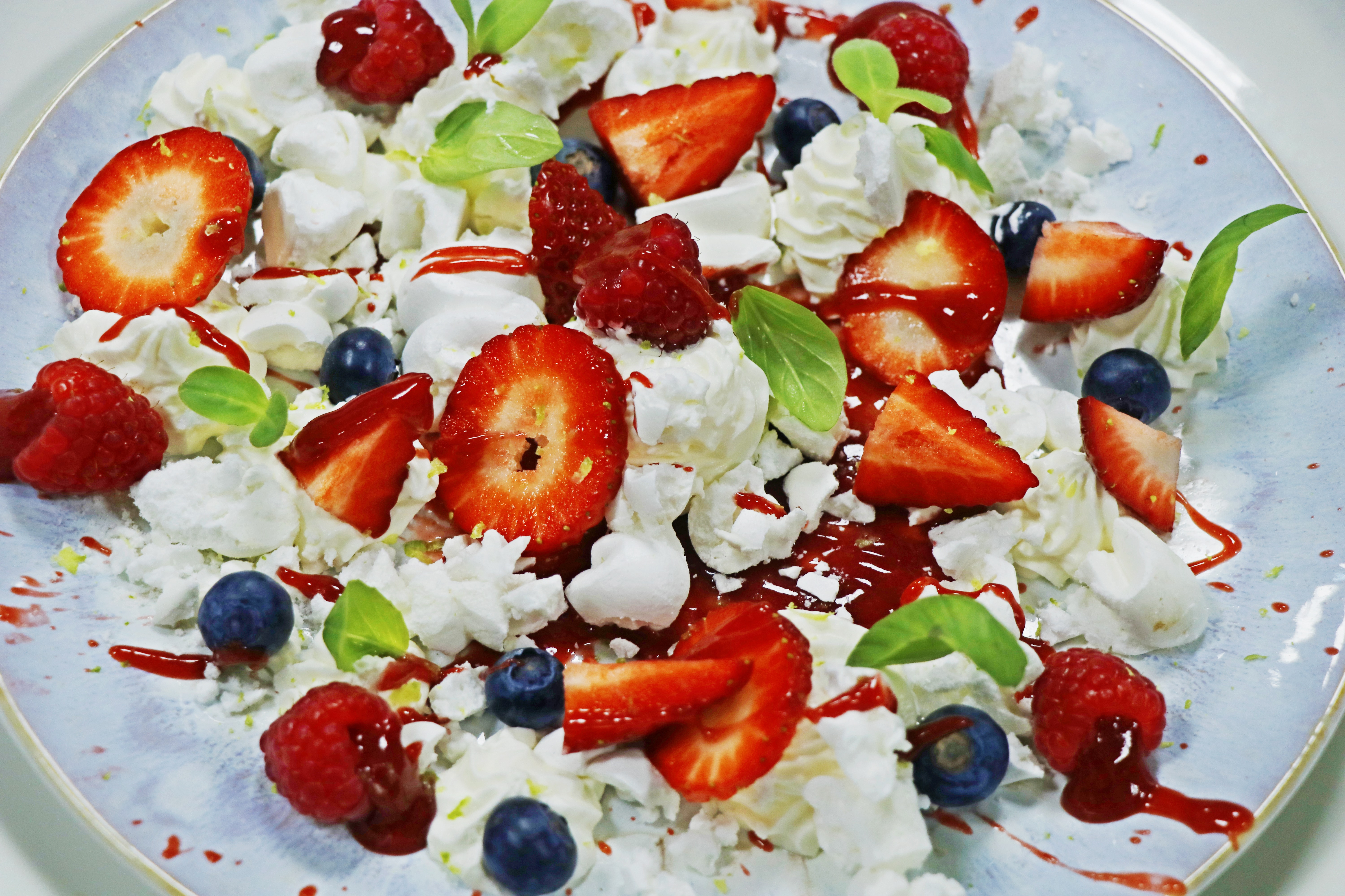 Eton mess traditional English dessert consisting of a mixture of strawberries, meringue, and whipped cream